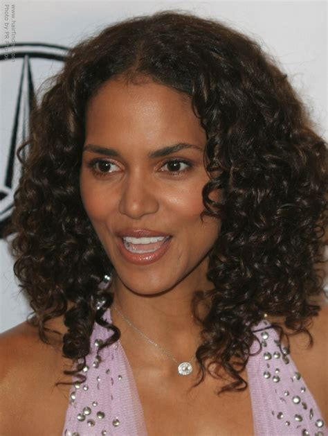 curly q hairstyles halle berry s long hair with small spiral curls