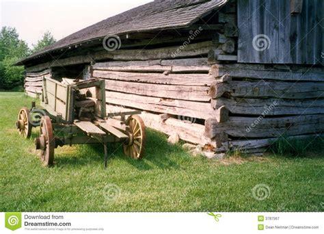 log barn plans old log barn and farm wagon stock image image 3787567