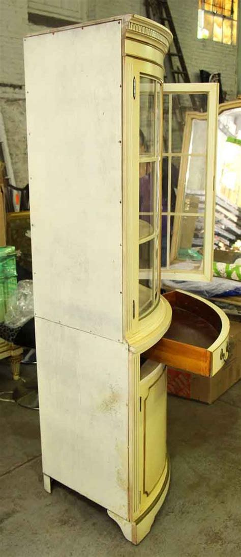country corner cabinet with curved glass front