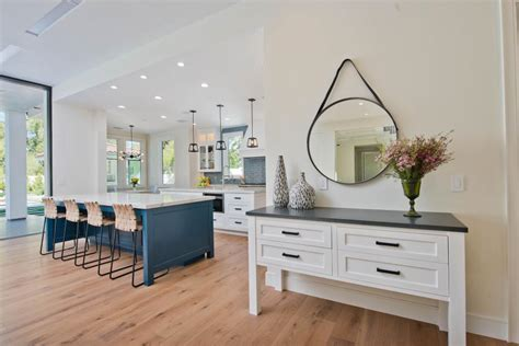 bright white kitchen with dual islands 2018 hgtv s