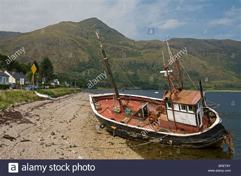 boat transport hshire fishing boat beached on the shoreline at low tide ardgour