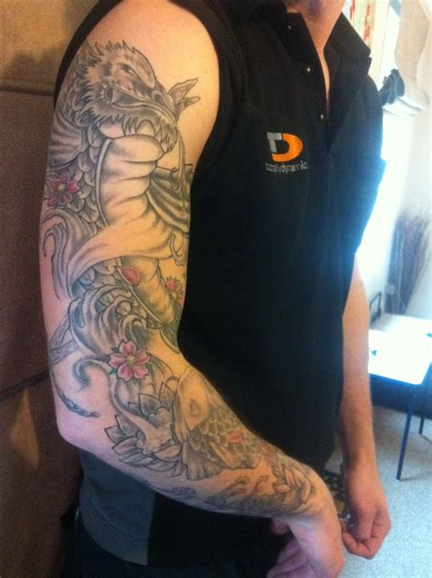koi tattoo pictures arm koi dragon fish tattoo right arm sleeve by spinksy777