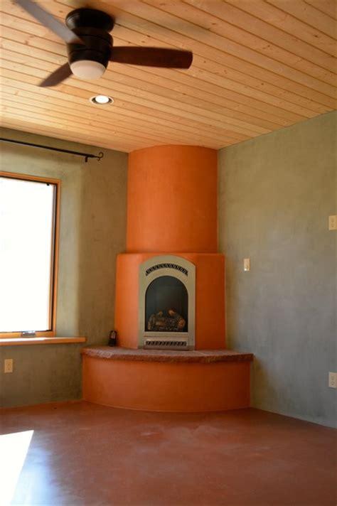 Kiva Style Fireplace by Corner Kiva Fireplace Southwestern Bedroom