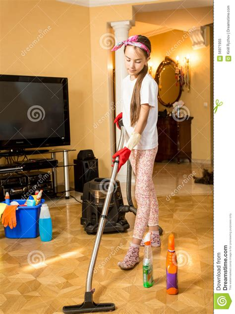 teenage girl cleaning floor  living room  vacuum