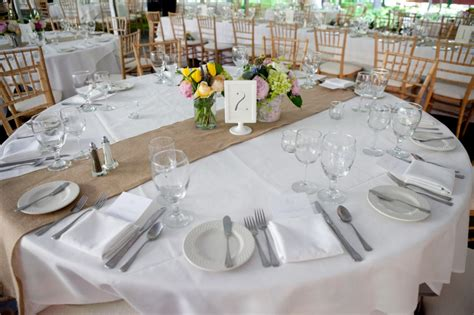 Rustic wedding centerpieces with large round table and small accent vases nytexas