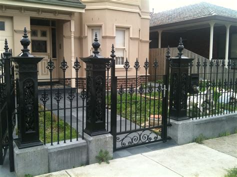 black wrought iron front yard fence with decorative