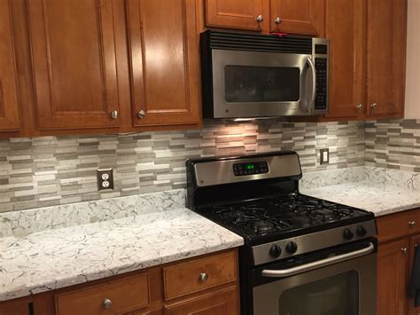 how to install backsplash in kitchen done installing backsplash over new countertops gray