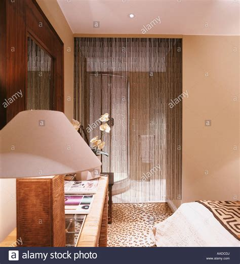 console table in bedroom l on console table in bedroom with beaded curtain stock photo royalty free image