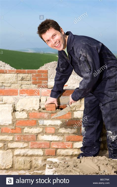 bricklaying wall with trowel stock photo royalty free
