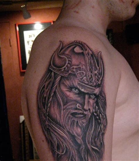 viking shoulder tattoo glaring viking on shoulder