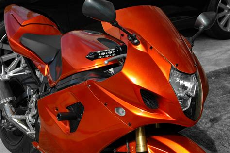 how to paint your motorcycle in your garage tangerine and how to build a paint booth
