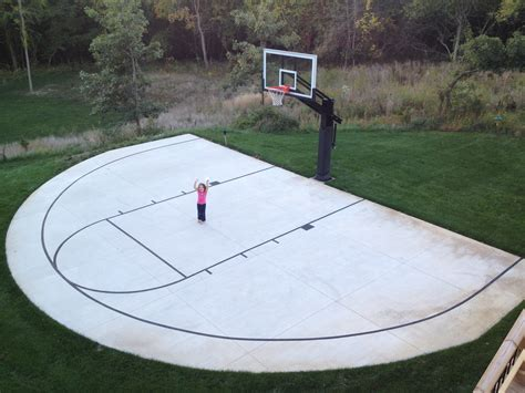 Half Court Basketball Dimensions For A Backyard by A Backyard Half Court With Striping Is Can Be An Inspiring