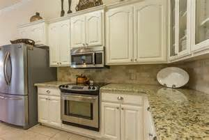 White Kitchen Cabinets With Stainless Appliances antique white kitchen cabinets with stainless steel appliances and