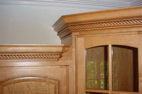 Install Crown Molding On Kitchen Cabinets by Crown Transitions For Corner Cabinets