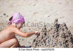 child nudism stock images of building a sand castle little girl on