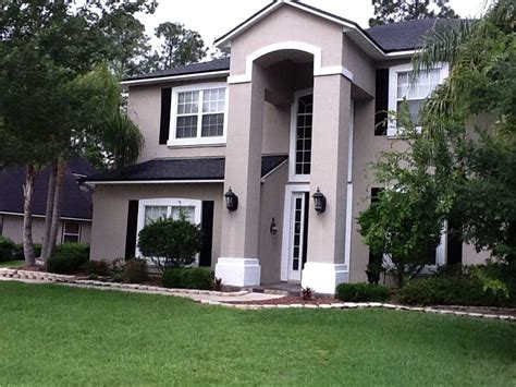 how much to stucco a house how to paint a stucco house with dark cream wall paint color ideas home interior