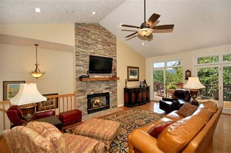 floor  ceiling stone fireplacevaulted ceiling