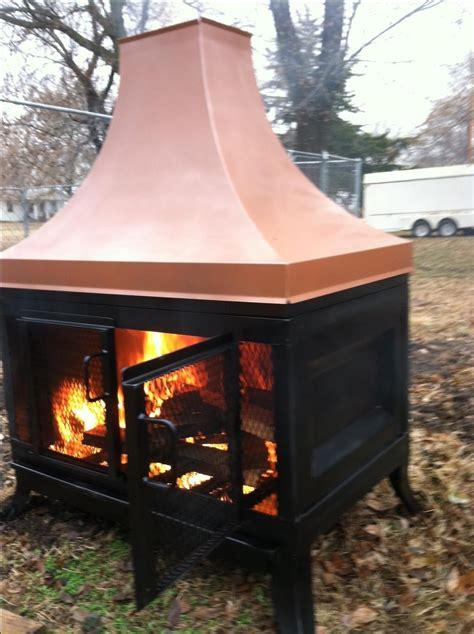 handmade custom outdoor fireplace by kutz metalwork