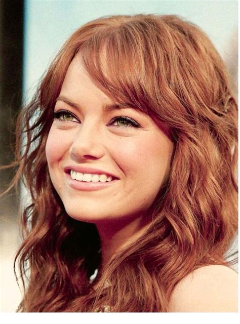 red hair on round face medium length hair with subtle side bangs in a round face