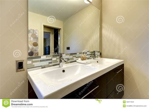 modern bathroom large double white sink  mirror stock