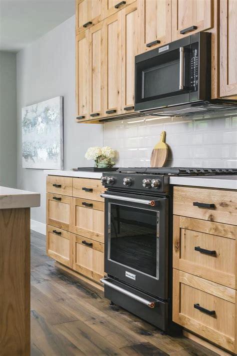 contemporary kitchen  black gas range  wood