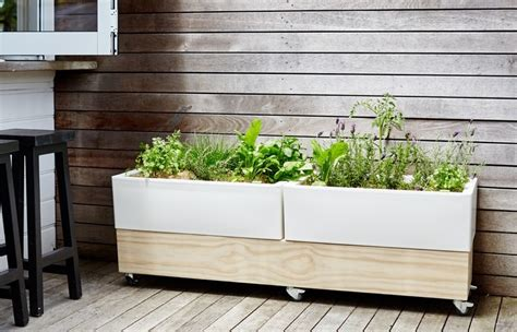 why we love self watering planters zerosoil gardens why we love self watering hdpe planters stepsto