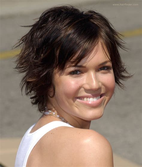 short and carefree with full bangs haircut for women mandy moore s hair in a carefree grown out pixie with bangs