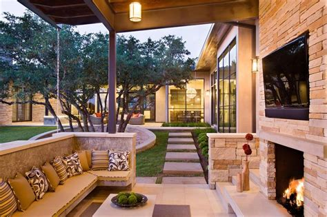 outside living family home with outdoor living room and pool modern