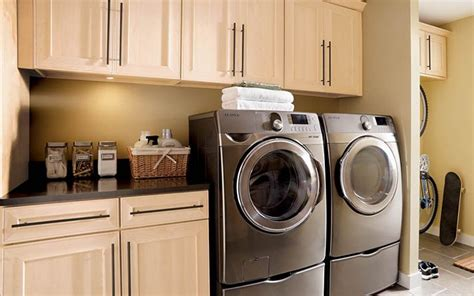 kraftmaid laundry room cabinets 17 best images about laundry rooms on maple cabinets laundry room and laundry tips