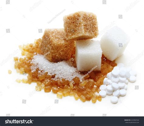 brown white cane sugar cubes and sugar substitute sweetener on white background stock photo