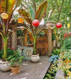 the patio at pastiche backyard tropical patio with hanging lanterns and banana