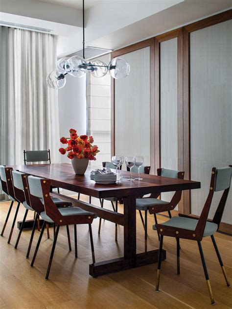 midcentury modern dining room with globe pendant light
