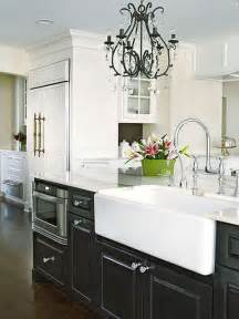 black cabinets with white farm sink contemporary