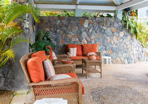 patio furniture for less patio furniture with orange cushion stock photo image