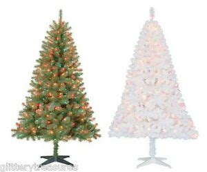 holiday time pre lit 65 madison pine white artificial christmas tree clear lights pre lit 6 5 pine artificial tree multi colored lights 2 color