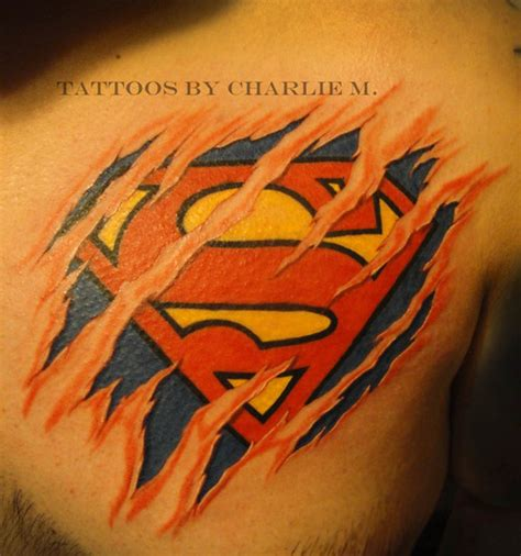 superman logo tattoo on chest red and black superman logo tattoo on right shoulder by robert