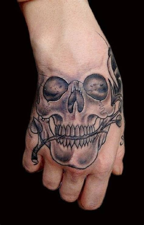 skull hand tattoo 15 unique skull tattoos designs collection designslayer