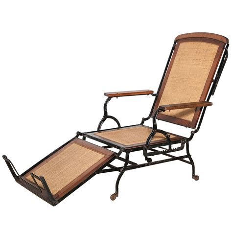 Cast Iron Lounge Chairs by Circa 1876 Rolling Walnut And Black Cast Iron Chaise
