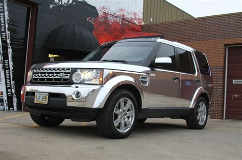chrome land rover chrome vinyl wrap on a lr4 land rover by revolution wraps