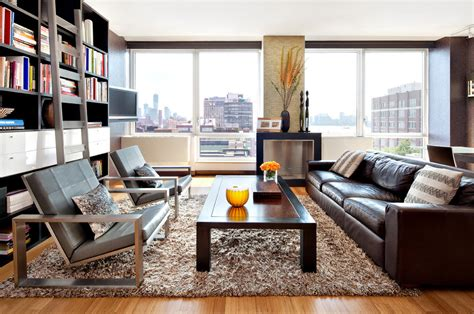 rugs that go with brown leather couch pretty shag rug in living room modern with rug on carpet