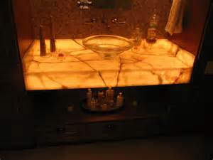 onyx bathroom countertops bahtroom glass holder beside sink crane and