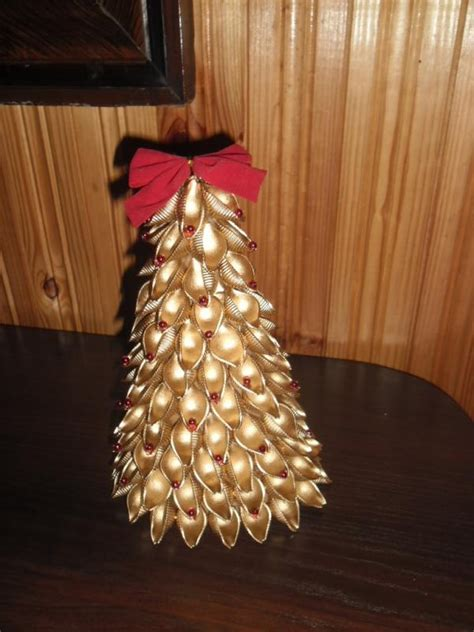 small christmas tree decorated with gold sprayed pasta
