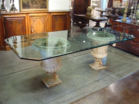 beveled glass table top on antique urns from