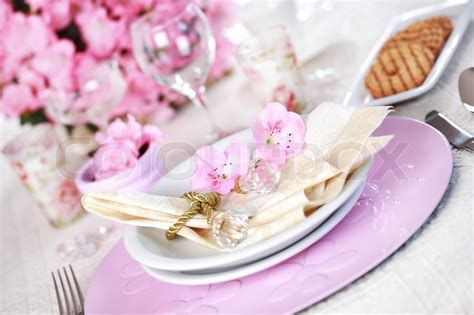 Luxury Pink luxury place setting in pink and white stock photo
