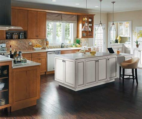 maple wood cabinets with white kitchen island homecrest