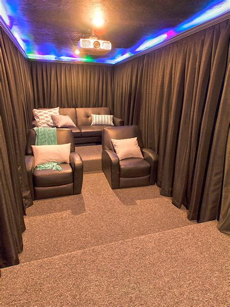 a diy home theater room hang curtains around your seats