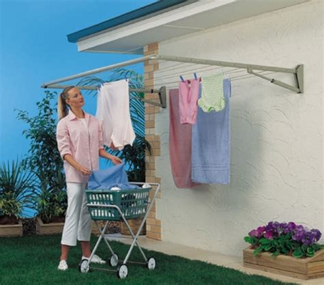 Ceiling Clothes Rack by Wall Mount Folding Drying Rack Apartment Therapy