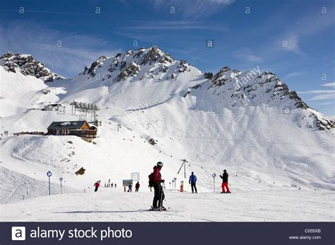 ski hutte skiers skiing on ski slopes with ulmer hutte