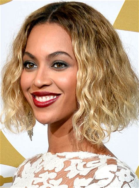 curly bob with part in the middle hairstyle beyonce s middle part curly short hairstyle at the 2014
