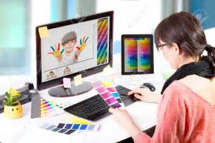 Designer 27356839 graphic designer at work color swatch samples stock photo